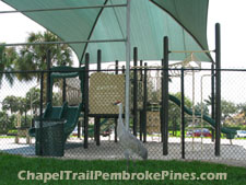 Childrens playground at Price Park located within the Chapel Trail community in western Pembroke Pines, Florida. A Sandhill Crane is shown in the foreground.